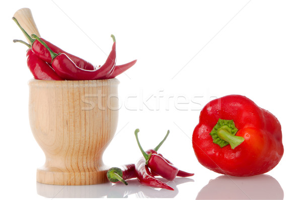 Red chili and bell pepper on wooden mortar  Stock photo © homydesign