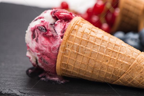 Cornet de crème glacée évider rouge fruits sombre Photo stock © homydesign