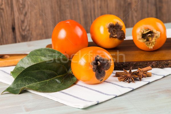 Orange persimmons Stock photo © homydesign