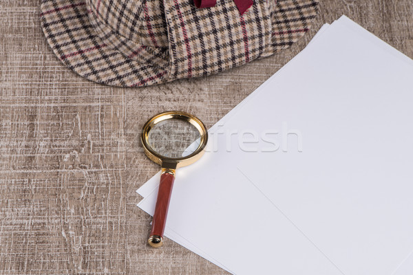 Paper sheets and magnifying glass Stock photo © homydesign