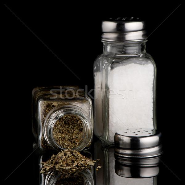 Salt and oregano shakers Stock photo © homydesign