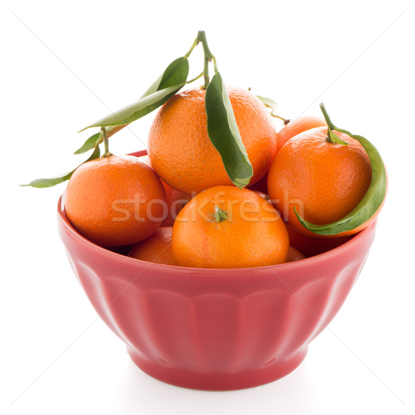 Tangerines on ceramic red bowl  Stock photo © homydesign