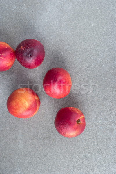 Fresh peaches on concrete Stock photo © homydesign