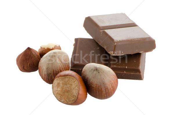 Csokoládé szelet mogyoró fehér levél háttér fekete Stock fotó © homydesign