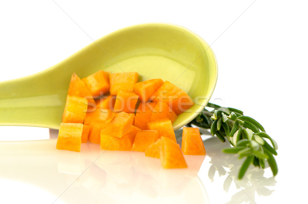 Green ceramic spoon with carrot pieces Stock photo © homydesign