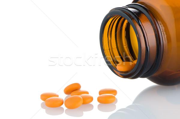 Pills from bottle Stock photo © homydesign