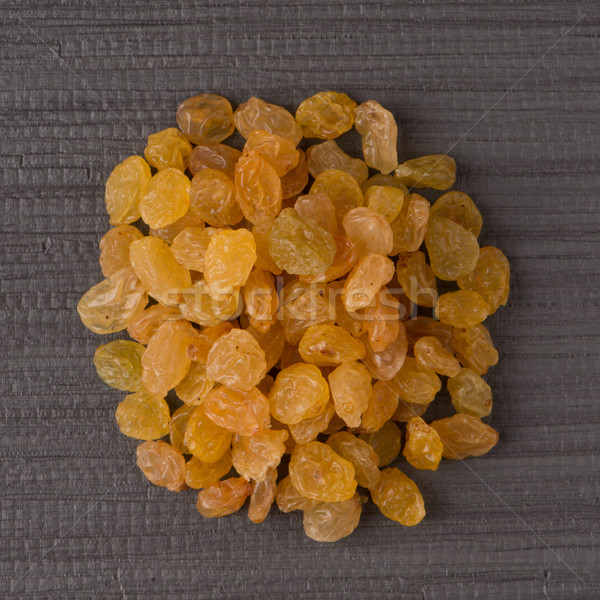 Círculo dourado passas de uva topo ver cinza Foto stock © homydesign
