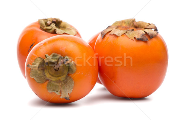 Persimmon fruits on white  Stock photo © homydesign