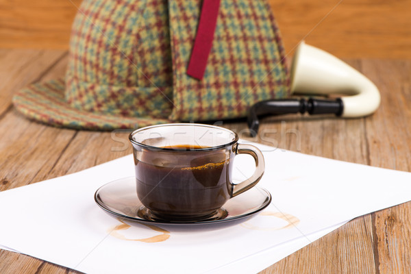 Coffee cup, paper sheets and detective hat Stock photo © homydesign