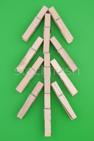 Pine tree made of wooden clothes pegs Stock photo © homydesign