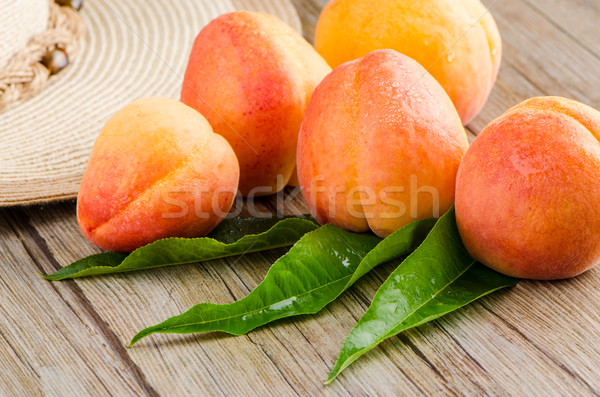 Apricots with leaves Stock photo © homydesign