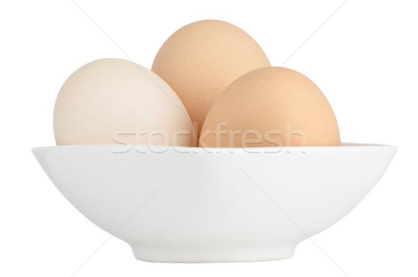 Brown eggs in white ceramic bowl Stock photo © homydesign