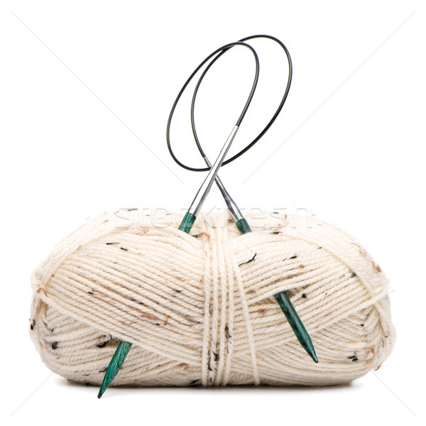 Stock photo: Beige knitting wool with needles