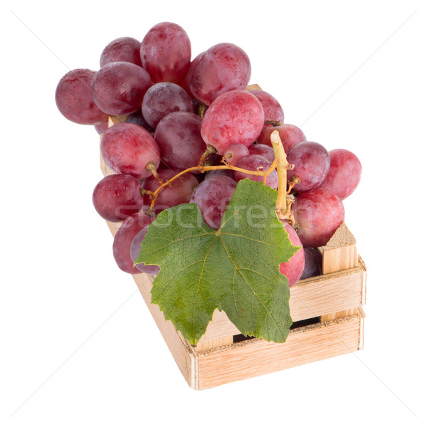 Red grapes in wooden crate Stock photo © homydesign