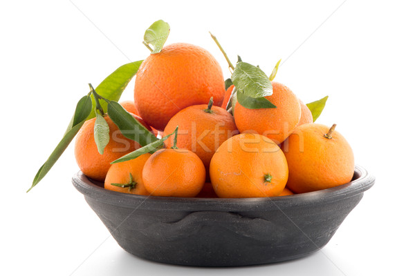 Tangerines on clay bowl  Stock photo © homydesign