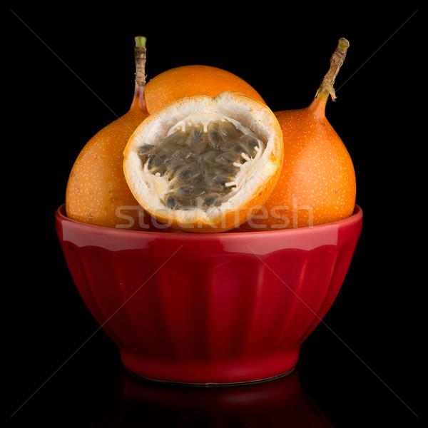 Passion fruits céramique rouge bol noir Photo stock © homydesign