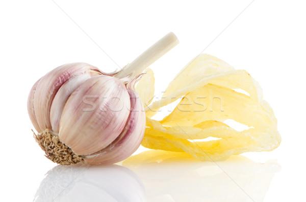Potato chips and garlic Stock photo © homydesign