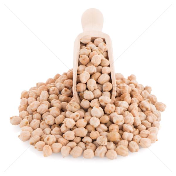 Uncooked chickpeas and wooden scoop Stock photo © homydesign