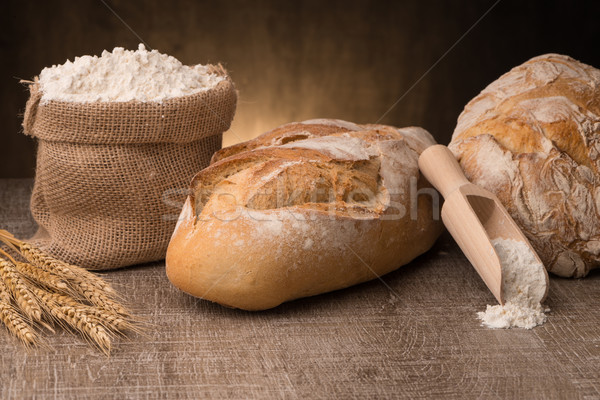 Rustic bread and wheat Stock photo © homydesign
