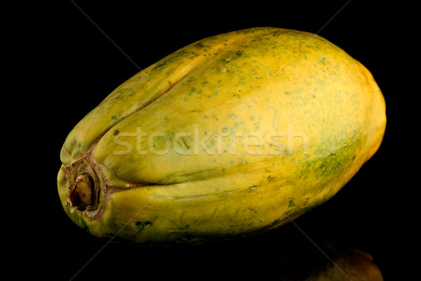 Papaya fruit on black background Stock photo © homydesign