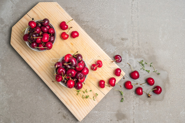 Red ripe cherries in ceramic bowls Stock photo © homydesign