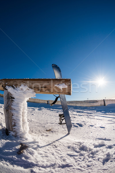 Snowboard leaning on a wood rail Stock photo © homydesign