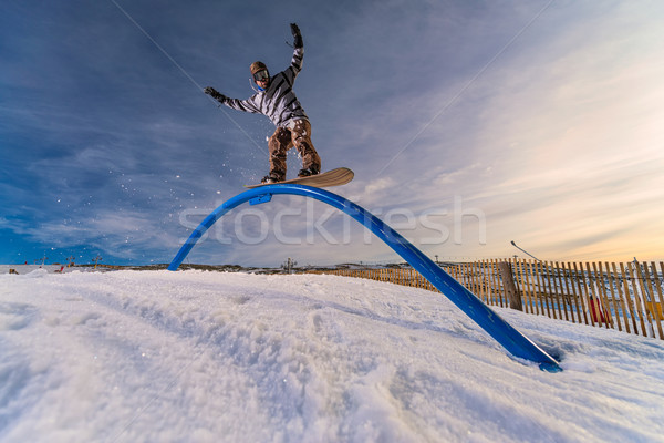 Snowboarder sliding on a rail Stock photo © homydesign