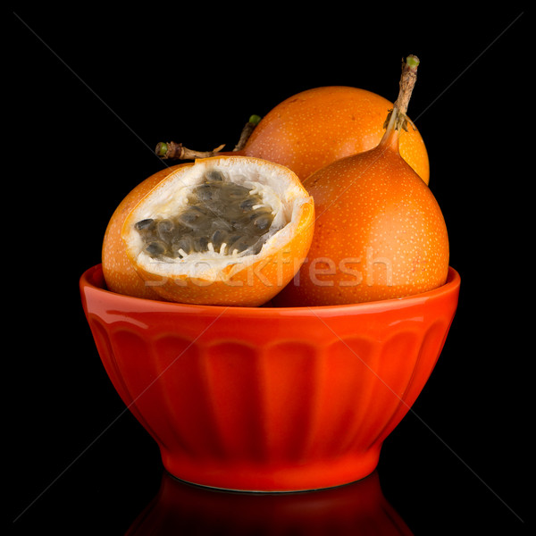 Tutku meyve seramik turuncu çanak siyah Stok fotoğraf © homydesign