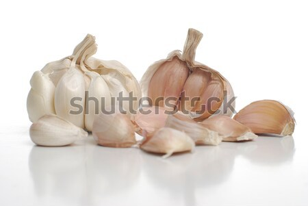 Two garlic and kitchen knife  Stock photo © homydesign
