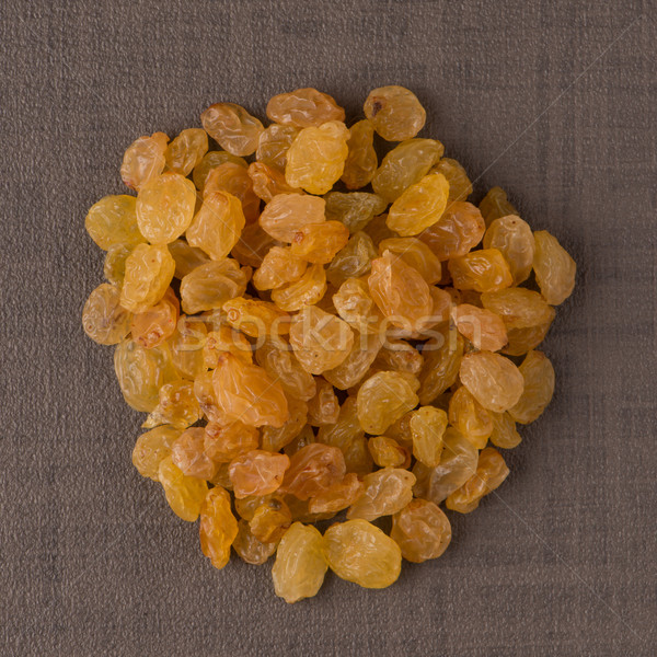 Circle of golden raisins Stock photo © homydesign