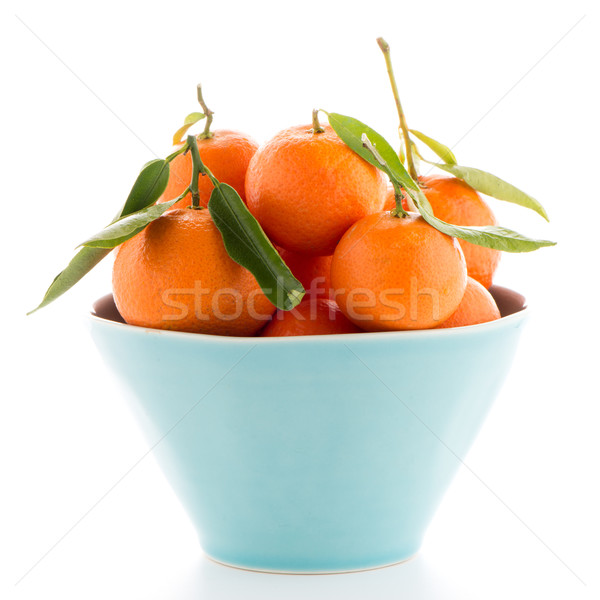 Tangerines on ceramic blue bowl  Stock photo © homydesign