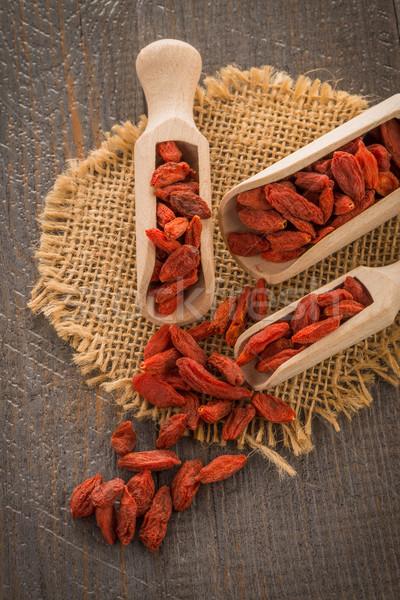 Bogyók fából készült kanalak gyógyszer csoport gyümölcsök Stock fotó © homydesign