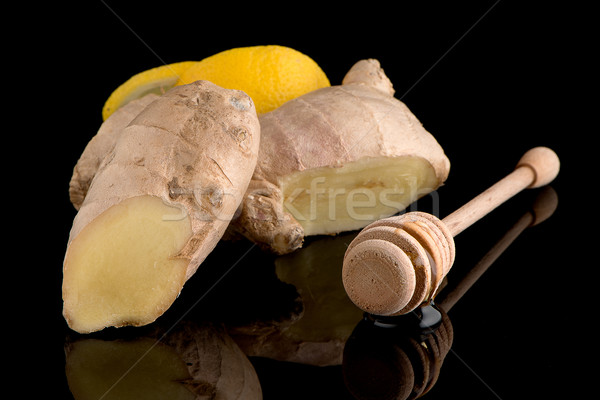 Ginger root on black Stock photo © homydesign