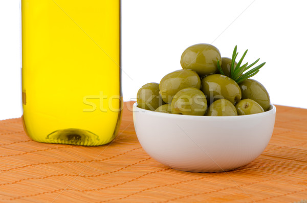 Stock photo: Green olives in a white ceramic bowl