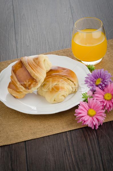 Croissants with orange juice Stock photo © homydesign