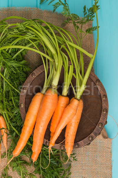 Carrots on a wooden table Stock photo © homydesign