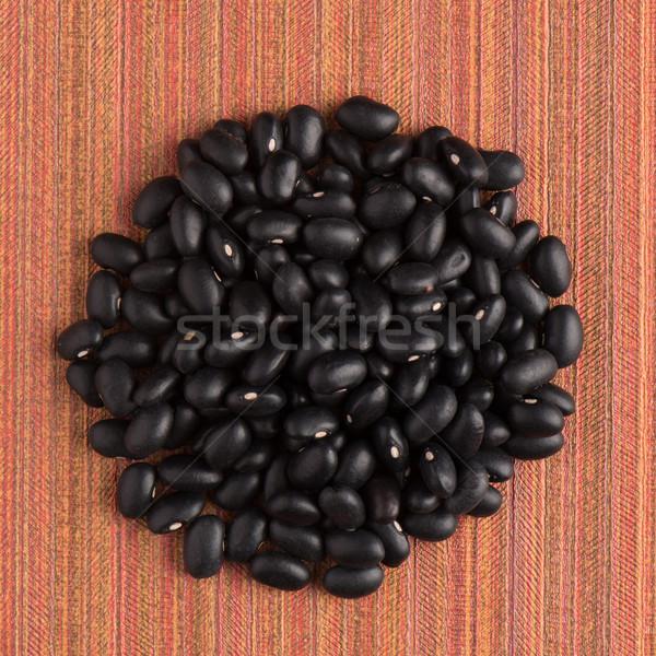 Circle of black beans Stock photo © homydesign