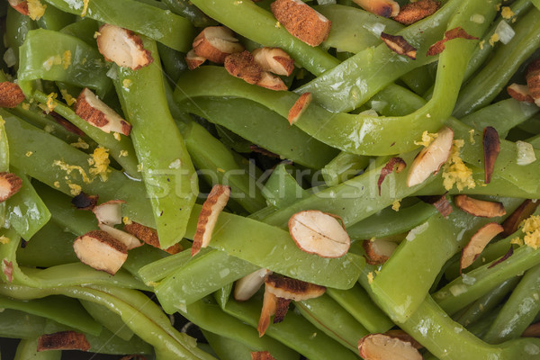 Green beans with roasted almonds Stock photo © homydesign