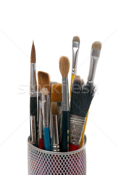 Paintbrushes in a metal mesh holder Stock photo © homydesign