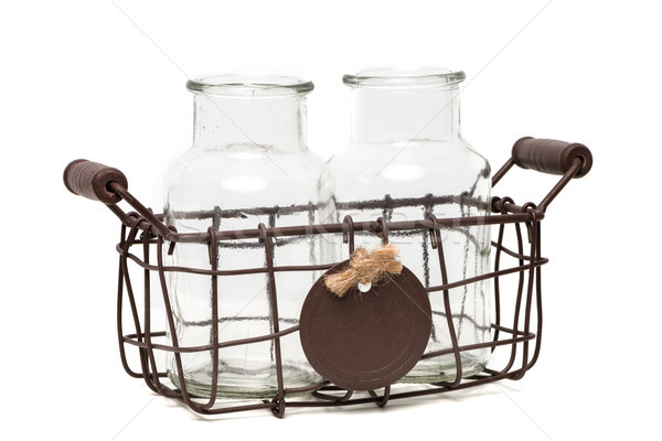 Two empty glass bottless in a vintage wire basket Stock photo © homydesign