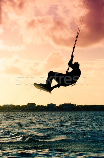 Silhouette of a kitesurfer flying Stock photo © homydesign
