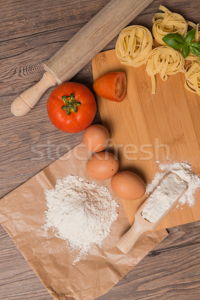 Raw pasta, tomato and eggs Stock photo © homydesign