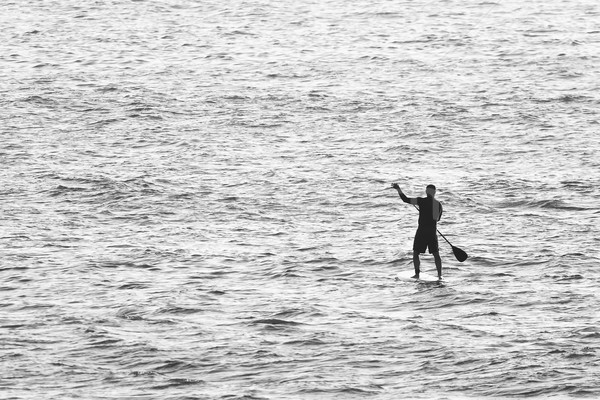 Man on Stand Up Paddle Board Stock photo © homydesign
