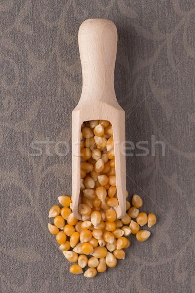 Wooden scoop with corn Stock photo © homydesign