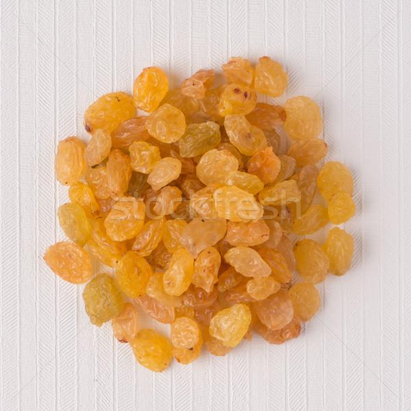 Circle of golden raisins Stock photo © homydesign