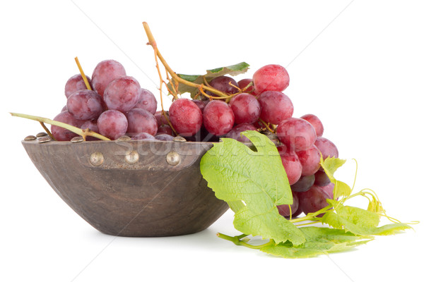 Fresh red grapes in wood bown Stock photo © homydesign