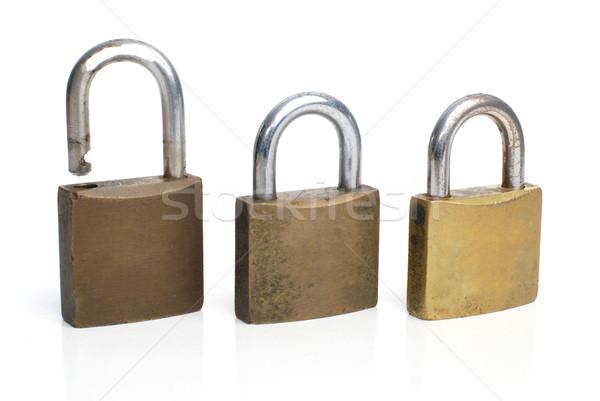 Trois sécurité or rangée isolé blanche Photo stock © homydesign
