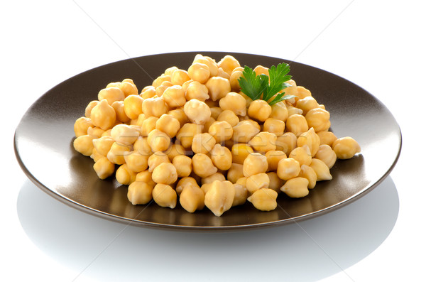 Chickpeas in a brown plate Stock photo © homydesign
