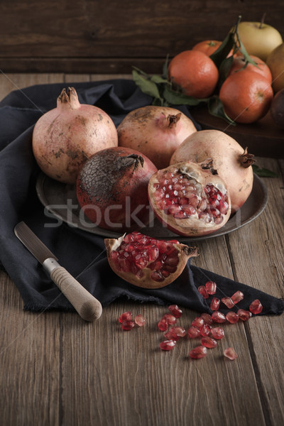 Stock photo: Pomegranate fruit on rustic table