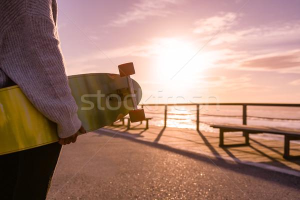 Girl holding a skateboard  Stock photo © homydesign